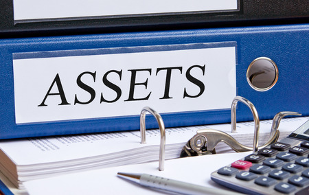 tangible asset: Assets - blue binder in the office Stock Photo
