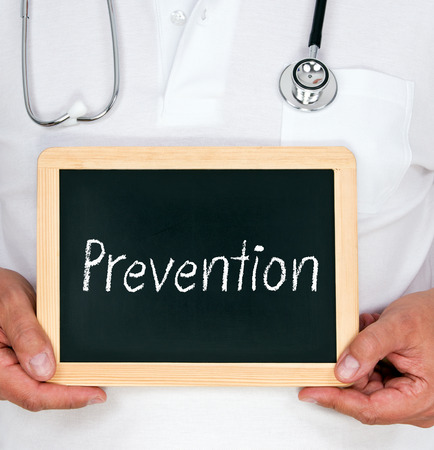 Prevention - Doctor with chalkboard photo