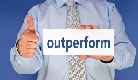 outperform - Businessman with thumb up photo