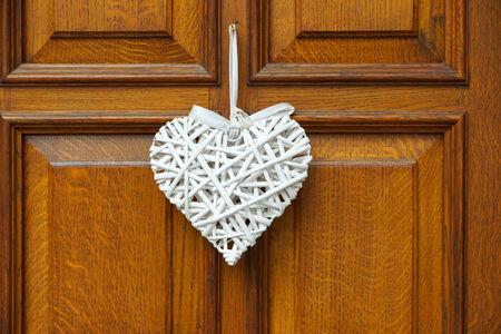 back gate: White Heart on wooden door
