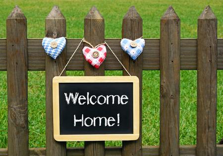bienvenida: Bienvenido a casa! Foto de archivo