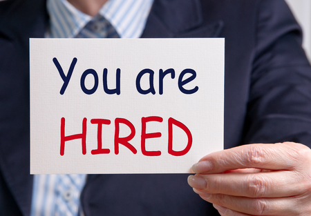 hired: You are hired Stock Photo