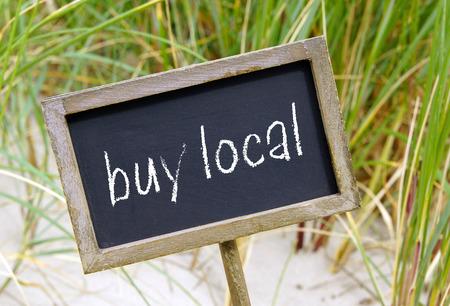 buy local Foto de archivo