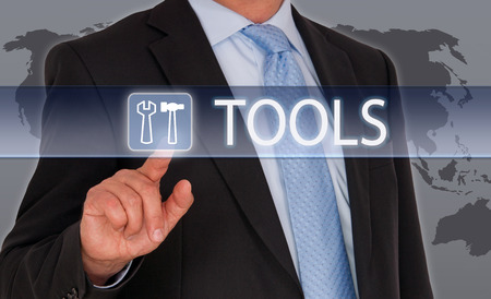 leadership potential: Tools - Businessman with touchscreen