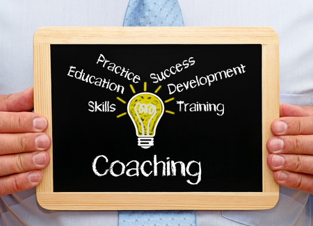 leadership potential: Coach with Coaching Chalkboard Stock Photo