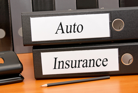 Auto Insurance files on table photo