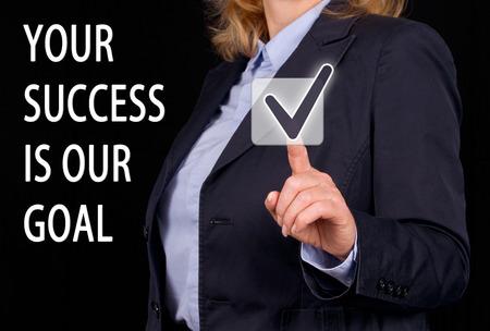 Uw succes is ons doel tekst met vrouw raken het juiste symbool Stockfoto