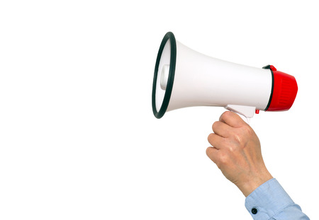 loud speaker: Megaphone with hand on white background Stock Photo