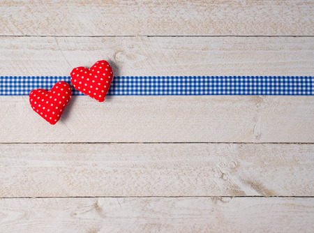 Two red Hearts on wooden Background photo