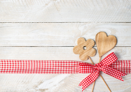 feelings of happiness: Flower and Heart on wooden background