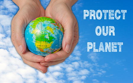 hands holding earth: Protect our Planet Stock Photo