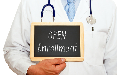 Open Enrollment - Doctor with chalkboard Banco de Imagens