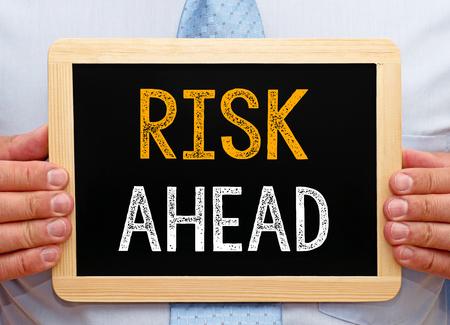 risk ahead: Risk ahead - Businessman with chalkboard Stock Photo