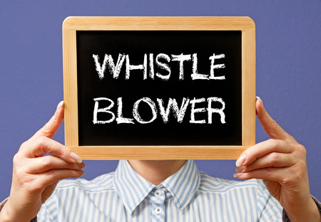 conspire: Whistle Blower Stock Photo