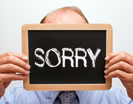 repentance: Sorry - Businessman with blackboard