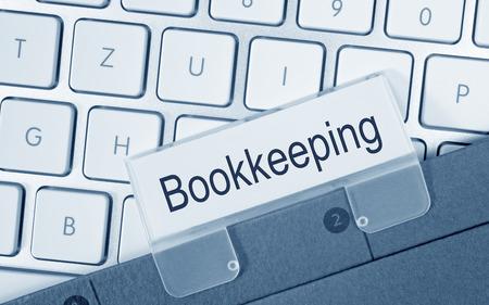 Bookkeeping - folder on computer keyboard