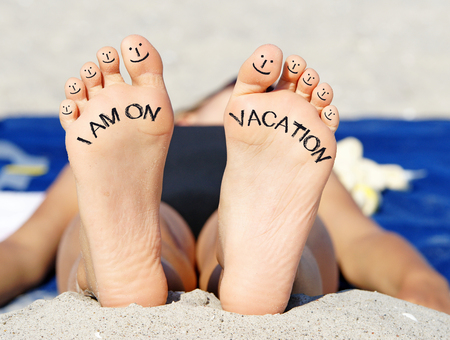 woman foot: I am on Vacation Stock Photo