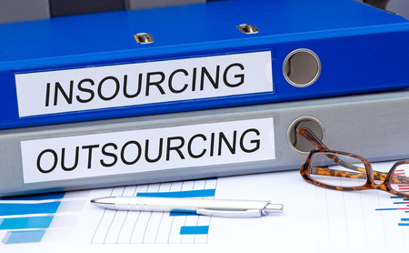 Insourcing and Outsourcing Banque d'images