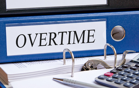 place of work: Overtime - blue binder in the office
