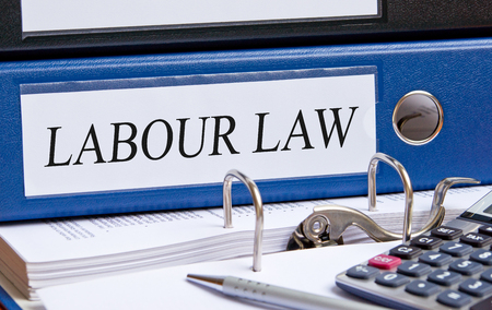 hire: Labour Law - blue binder in the office Stock Photo