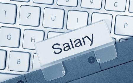 monthly salary: Salary - folder on computer keyboard Stock Photo