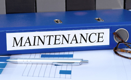 business software: Maintenance - blue binder in the office Stock Photo