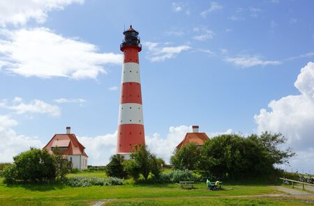 westerheversand lighthouse: Lighthouse at the coast Stock Photo