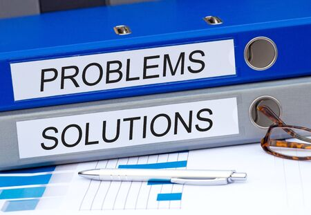 problems solutions: Problems and Solutions - two binders in the office Stock Photo