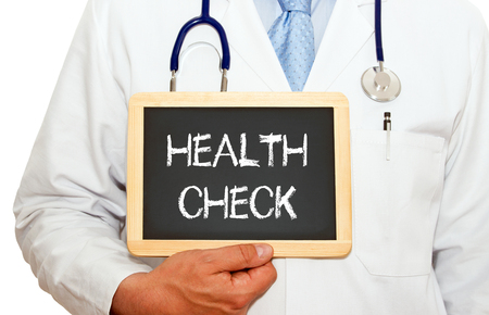 health check: Health Check - Doctor with chalkboard Stock Photo