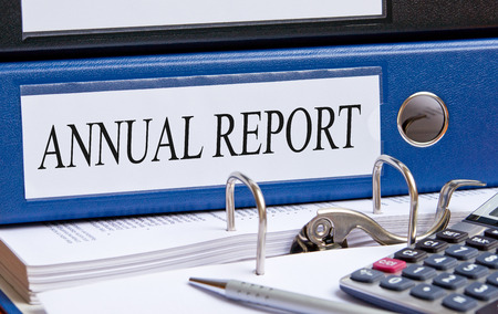 year financial statements: Annual Report - blue binder in the office