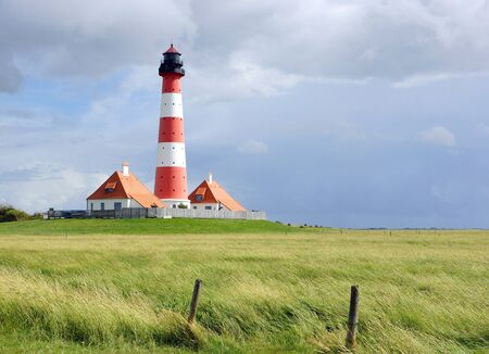 westerheversand lighthouse: Lighthouse at the Coast Stock Photo