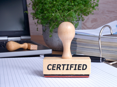 Certified - rubber stamp in the office Stockfoto