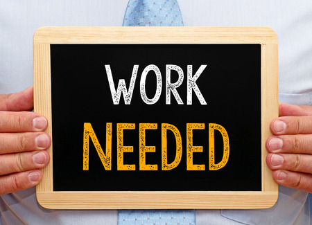 needed: Work needed - Manager with chalkboard Stock Photo