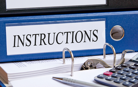 Instructions - blue binder in the office