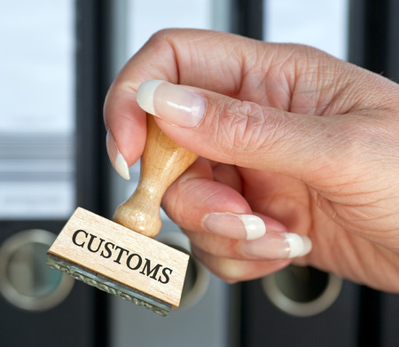 customs: Customs - rubber stamp with hand