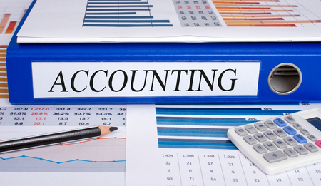 cash flow statement: Accounting - blue binder in the office
