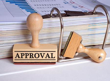approval: Approval - rubber stamp in the office