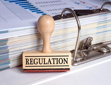Regulation rubber stamp with binder Stockfoto
