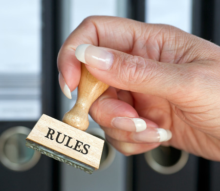office use: Rules Stamp with hand in the Office