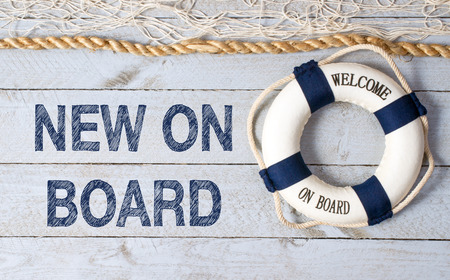 Nuevo a bordo - Bienvenido Foto de archivo