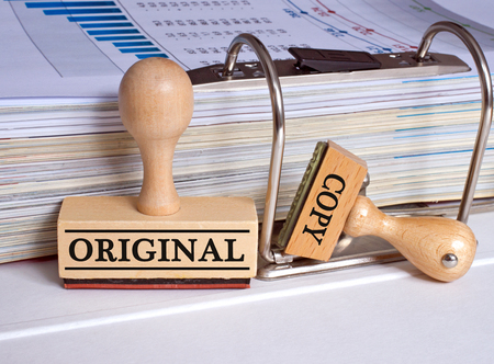 Original and Copy - two stamps in the office Stock Photo - 50027242