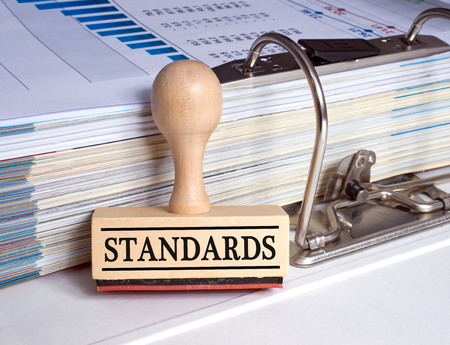 standards: Standards stamp with binder in the office