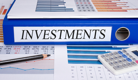 real business: Investments blue binder in the office