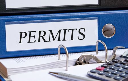 business administration: Permits blue binder in the office