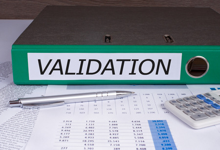 validation: Validation binders on desk in the office Stock Photo