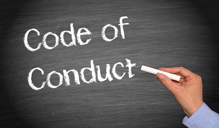 conduct: Code of Conduct chalkboard with female hand