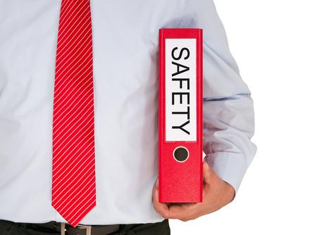 Seguridad en el Trabajo - Hombre de negocios con la carpeta