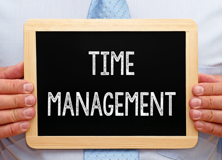 prioritization: Time Management - Businessman with Chalkboard