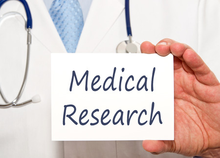 medical sign: Doctor with Medical Research Sign Stock Photo
