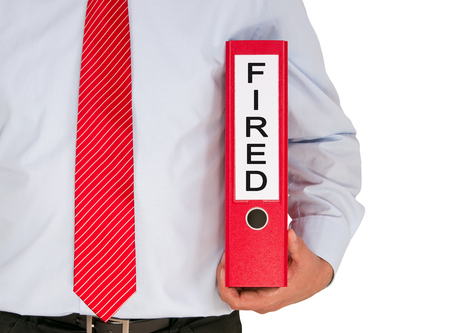 You are fired - Businessman with red binder Stock Photo